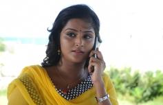 Remya Nambeeshan still from film Damaal Dumeel