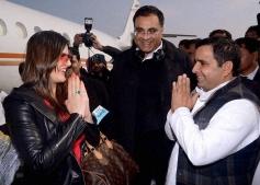 Samajwadi party MP Dharmendra Yadav greets Zarine Khan at Saifai airport in Lucknow