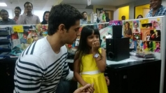 Sidharth Malhotra along with kid during the film Hasee Toh Phasee promotion at Fever 104 FM