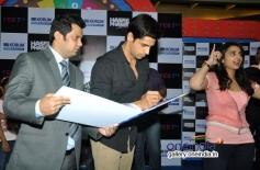 Sidharth Malhotra signs the KORUM autograph book