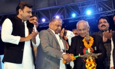 SP chief Mulayam Singh Yadav, Uttar Pradesh Chief Minister Akhilesh Yadav and others light the lamp