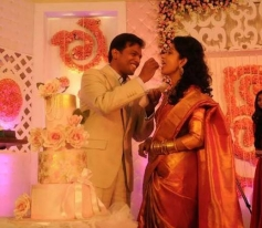 Anil John Titus sharing a piece of cake with Meera Jasmine