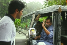 Dulquer Salman and Vinu Chakravarthy still from Vaayai Moodi Pesavum