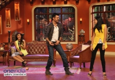 Harman Baweja perform with a girl on the sets of Comedy Nights with Kapil