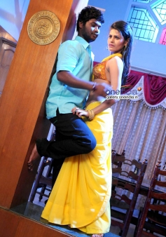 Rajesh and Dhoohi in Kannada Movie Love Is Poison