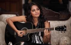 Abushka Shetty posing with Guitar