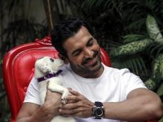 John Abraham poses with dog