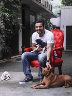 John Abraham poses with his pet dog