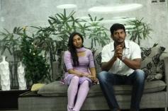 Lakshmi Menon and Vishal still from Naan Sigappu Manithan