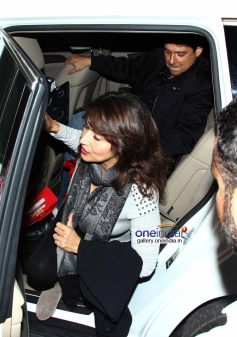 Madhuri Dixit with her husband leaves for IIFA 2014