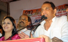 Mohammad Azharuddin campaigns for Nagma during an election campiagn rally in Meerut
