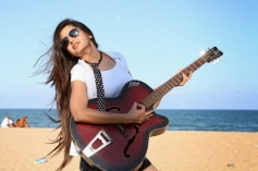 Poonam Kaur posing with Guitar