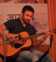 Saif Ali Khan posing with Guitar