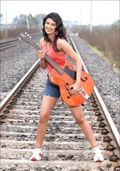 Sayali Bhagat posing with Guitar