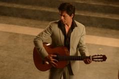 Shahrukh Khan posing with Guitar