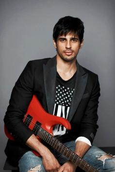 Sidharth Malhotra posing with Guitar