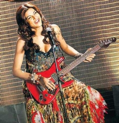 Sushmita Sen posing with Guitar