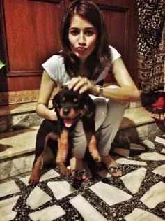 Syra Sheroz poses with her pet dog