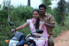 Mridula Vijay and TS Vasan in Jennifer Karuppaiya Bike Image