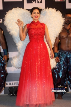 Sunny Leone Red Hot dress donning angel