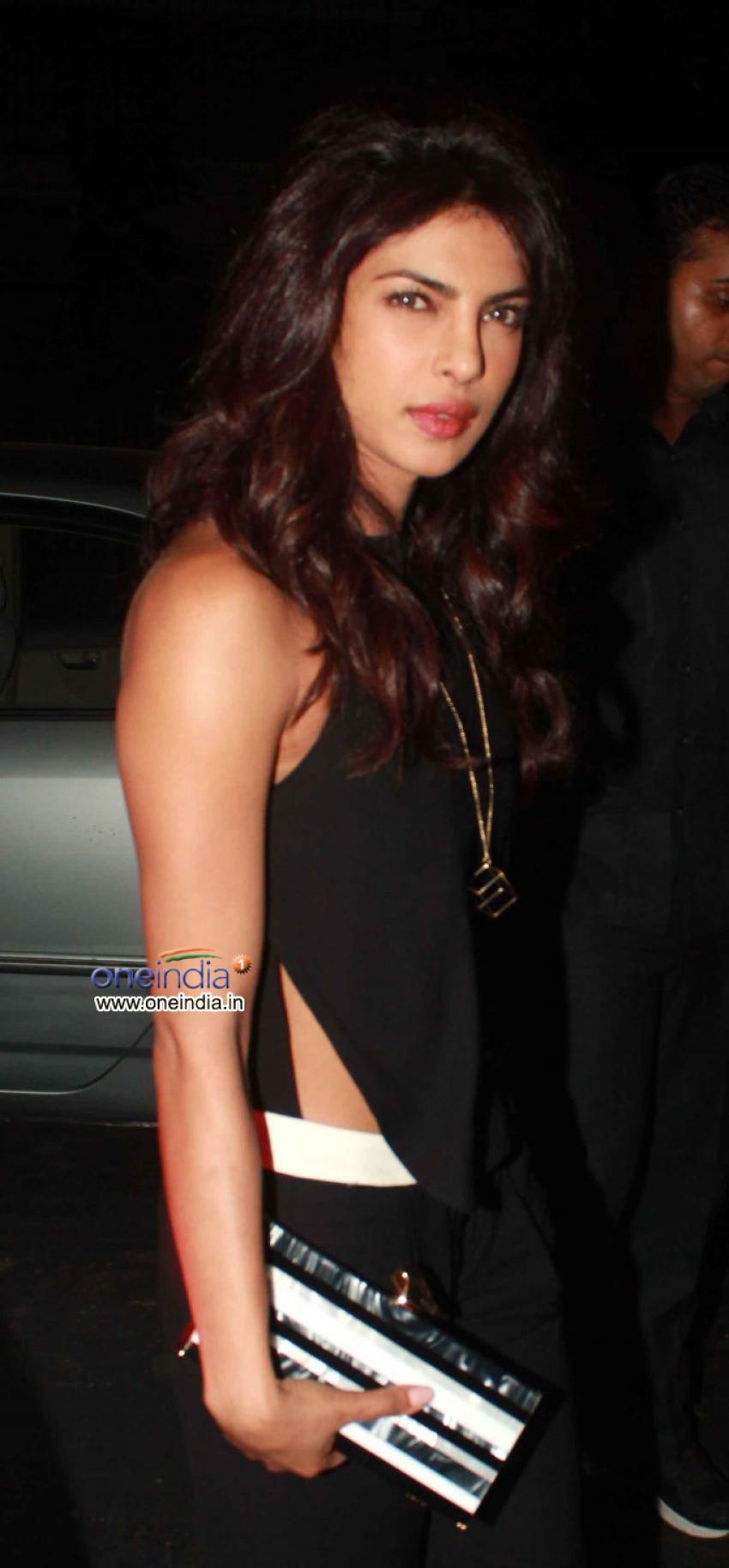 Priyanka Chopra Meets John Hamm at Aurus Photos