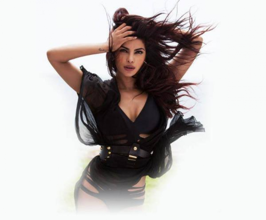 Priyanka Chopra's 'Exotic' Stills With Pitbull Photos