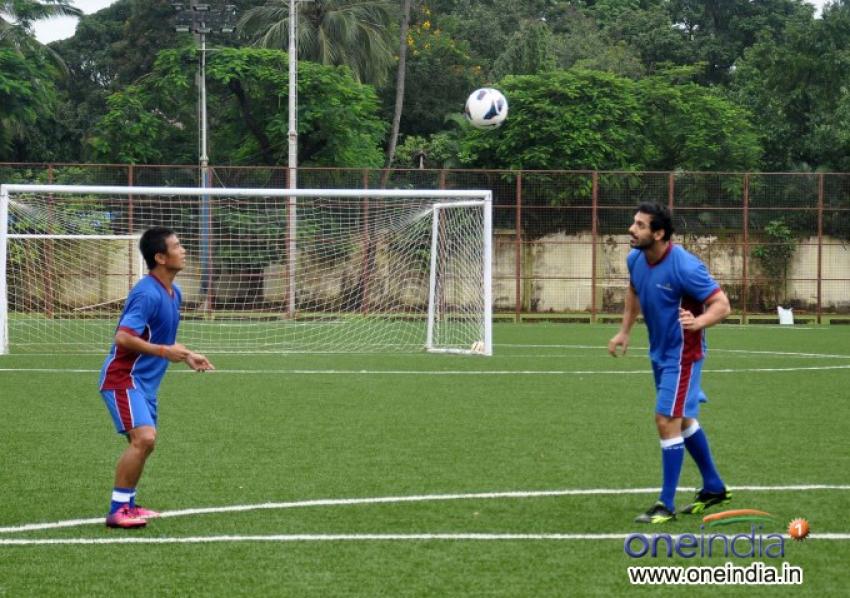 John Abraham and Baichung Bhutia playing a friendly soccer match Photos