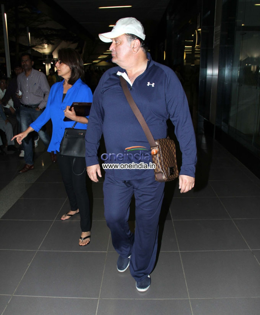 Rishi Kapoor, Neetu Singh and Randhir Kapoor snapped at Mumbai airport Photos