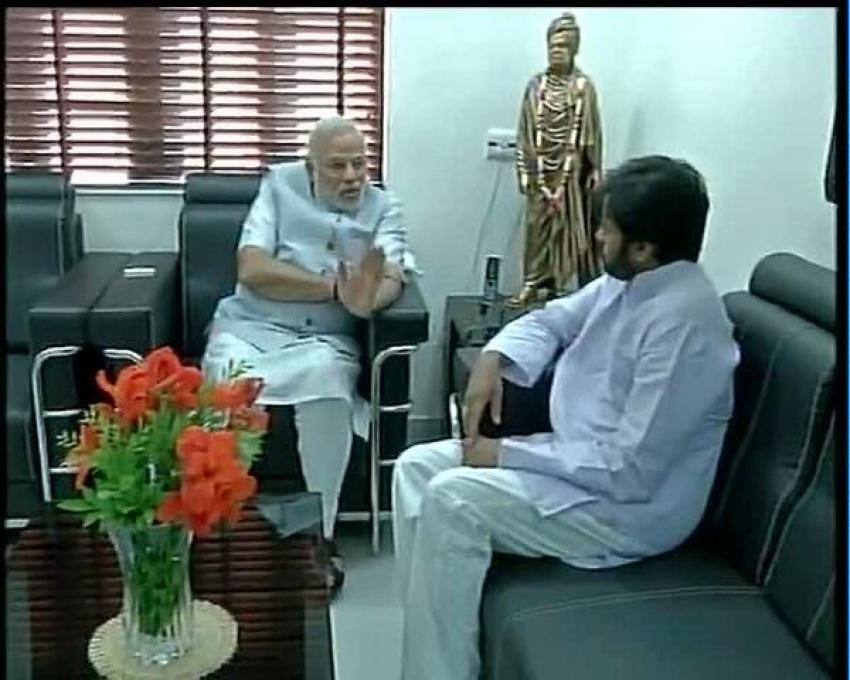 Narendra Modi interacts with Jana Sena founder Pawan Kalyan Photos