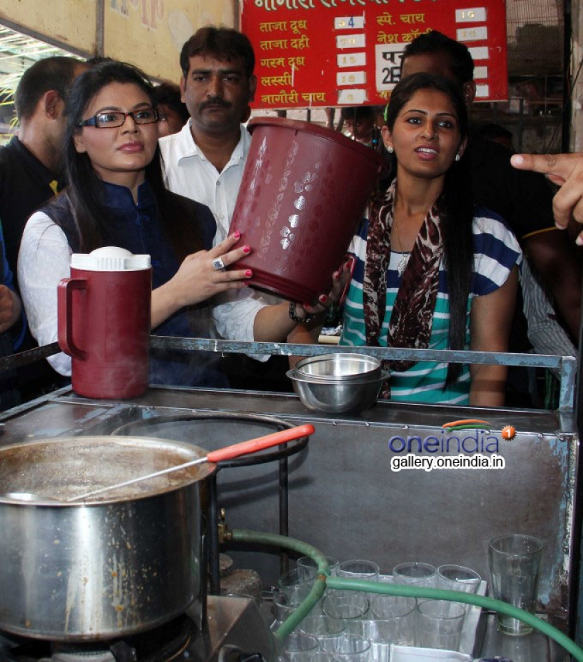 Rakhi Sawant distributes dustbins to needy people Photos