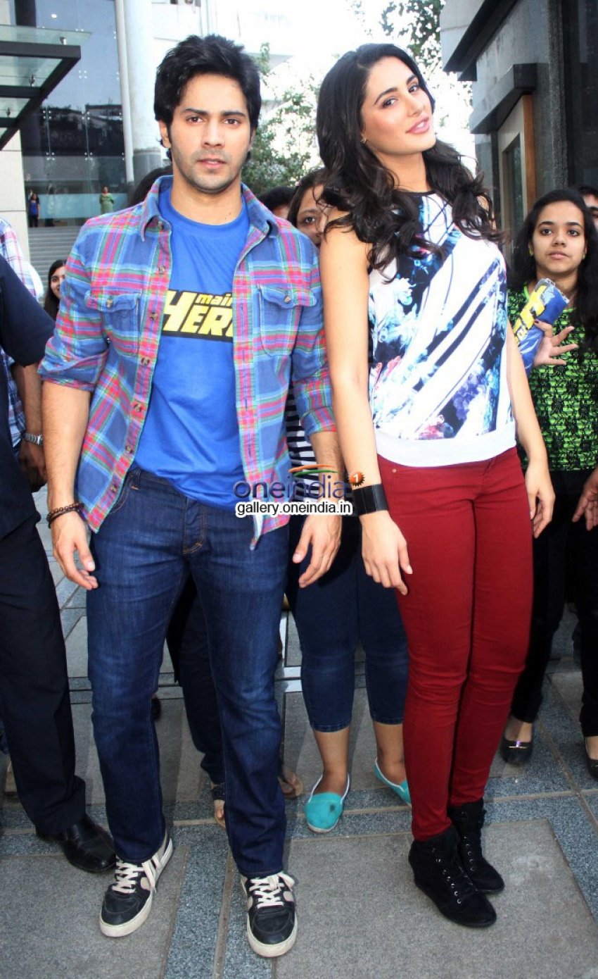 Varun Dhawan and Nargis Fakhri visits Mithibai College Photos