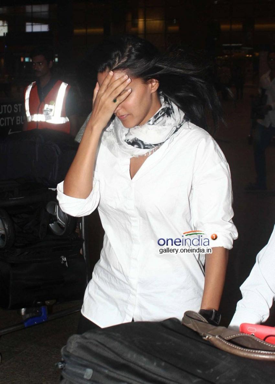 Neha Dhupia Snapped at Airport Photos