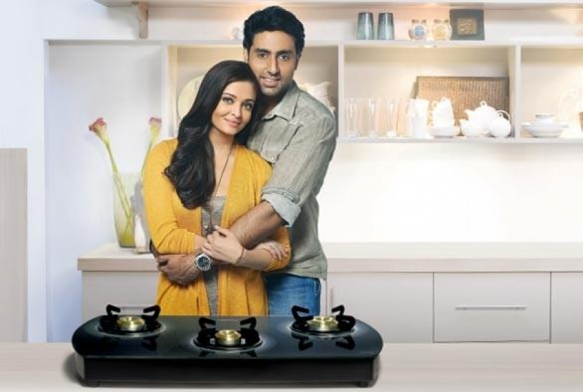 Abhishek Bachchan and Aishwarya's new Prestige ads Photos