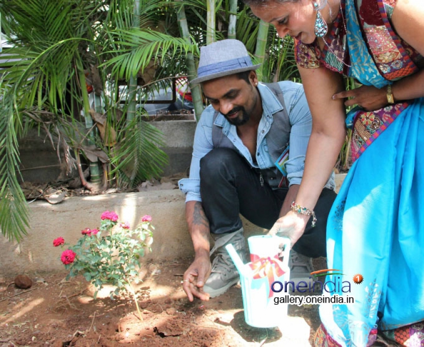 Remo D'Souza plants tree with school children for World Environment Day Photos