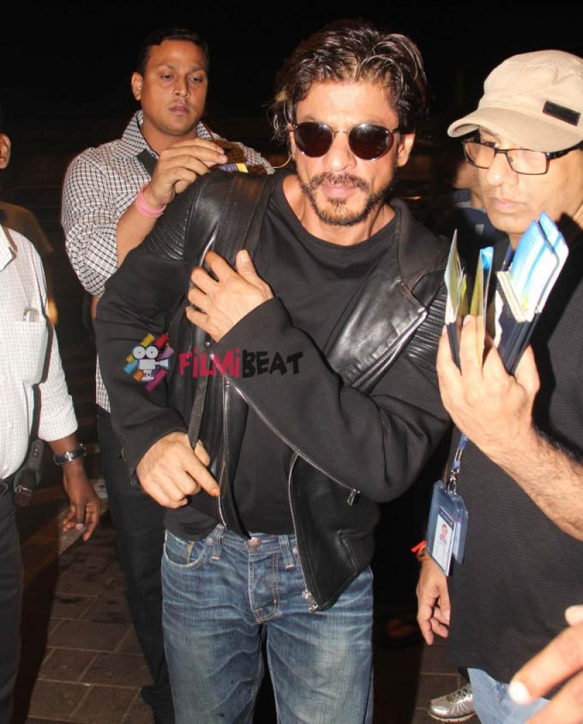 Shahrukh and Aryan Khan snapped at airport Photos