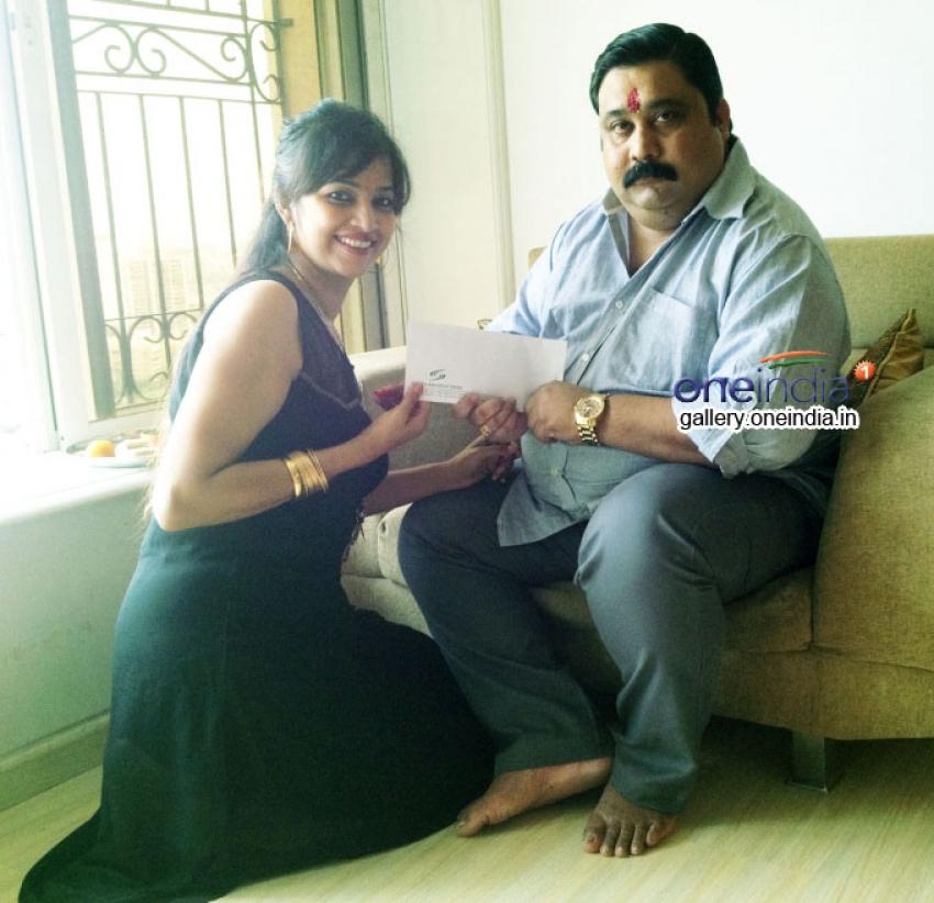 Tanisha Singh ties rakhi to her brother Anil Singh Photos