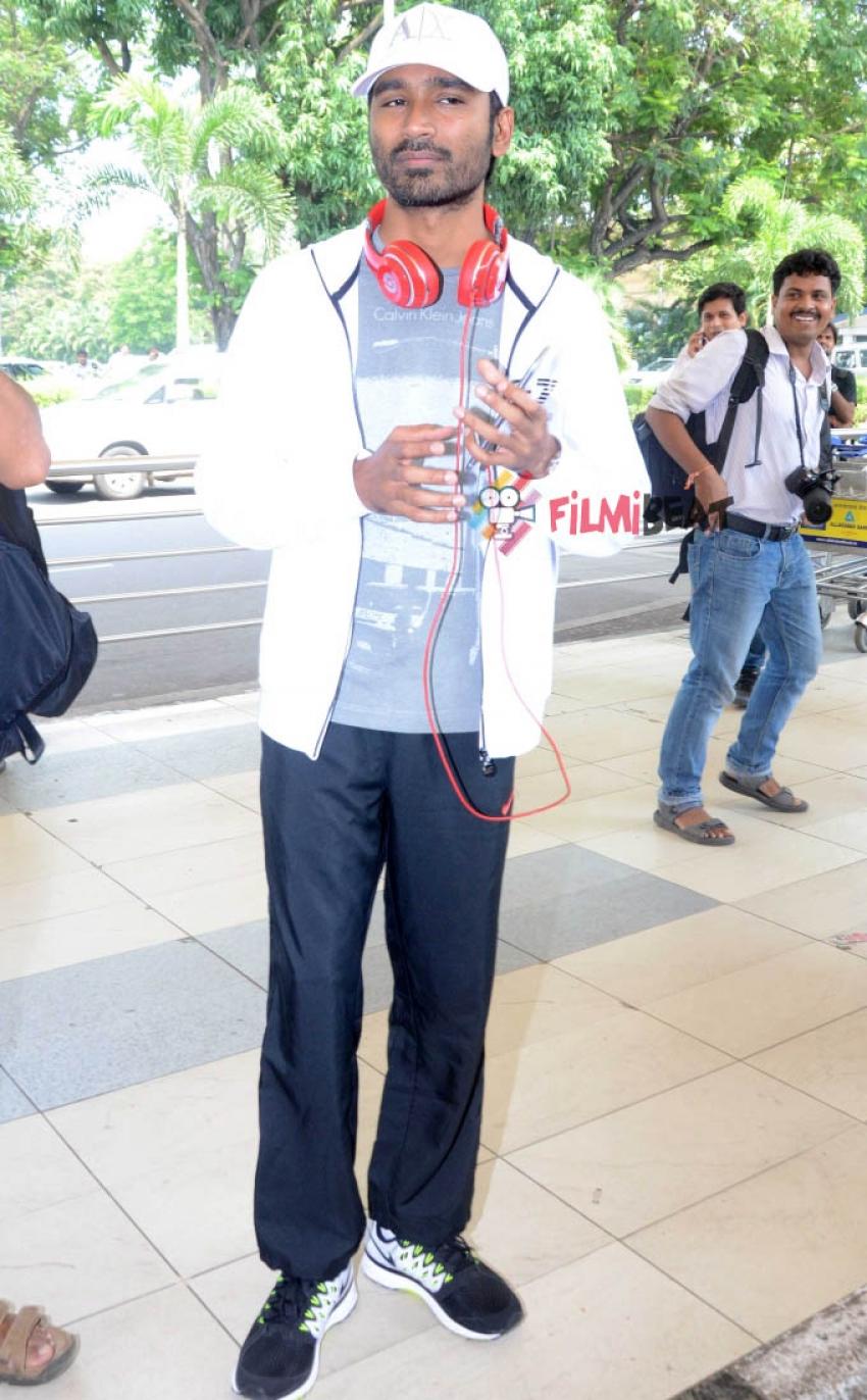 Dhanush Snapped At The Airport Photos