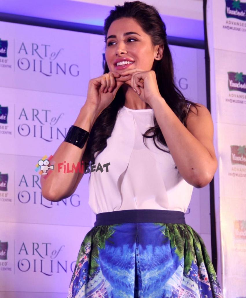 Nargis Fakhri Launches DIY Signature Line Of Massages Photos