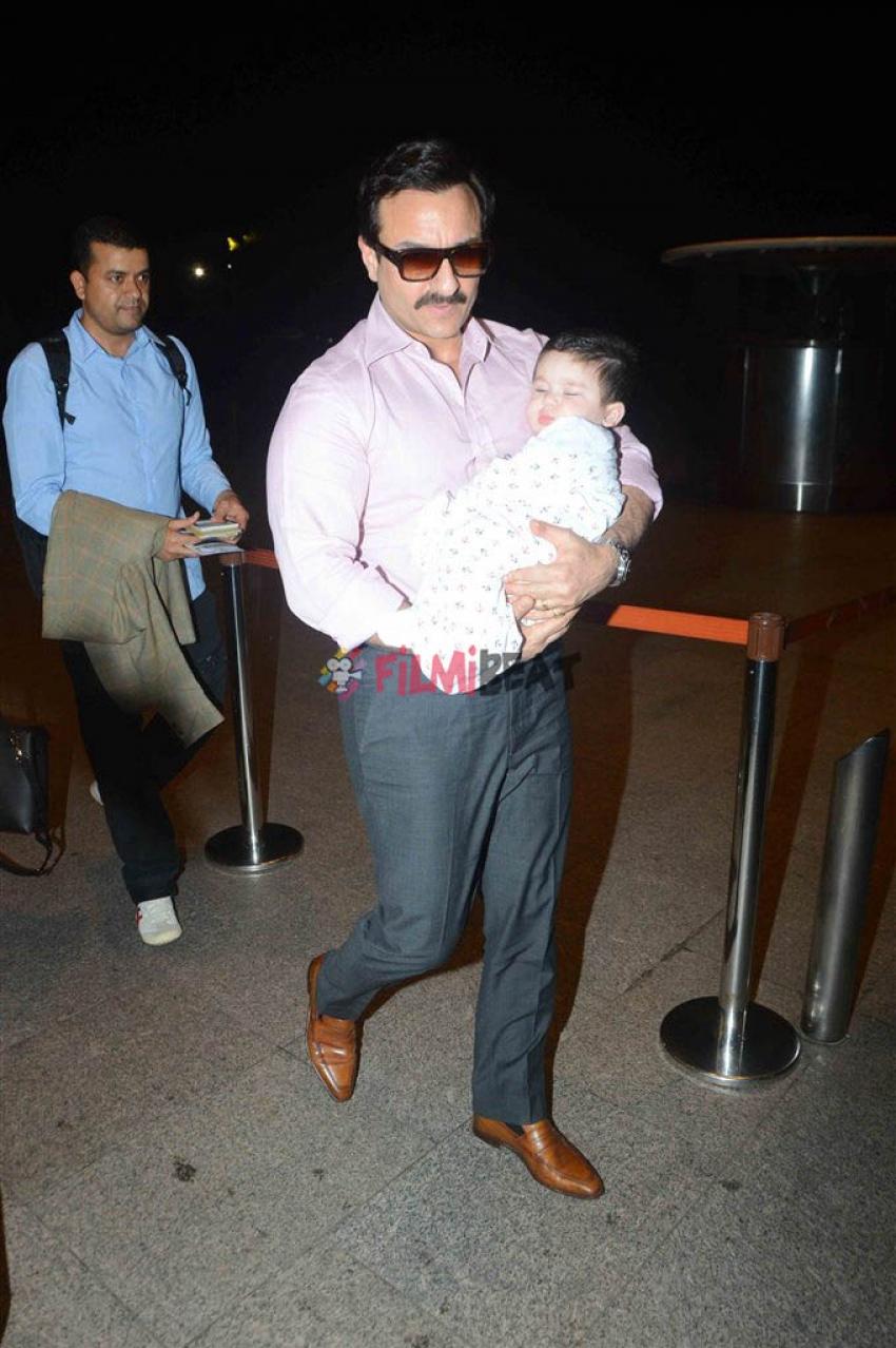 Saif & Kareena Spotted With Baby Taimur At Airport Photos