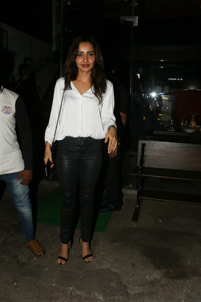 Neha Sharma With Bejoy Nambiar Spotted At Silver Beach Cafe Photos