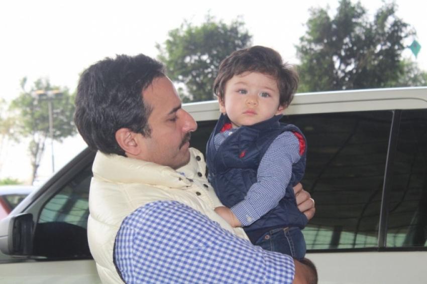 Saif Ali Khan, Kareena & Taimur Spotted At Airport Photos