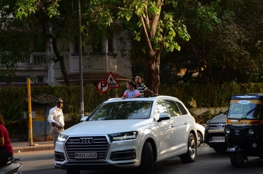 Sanjay Dutt Kids Snapped In Open Car Photos