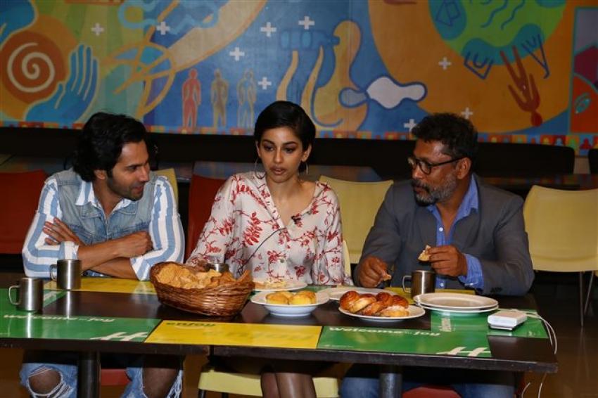 Varun Dhawan Turns A Hotel Employee In Real Life Photos
