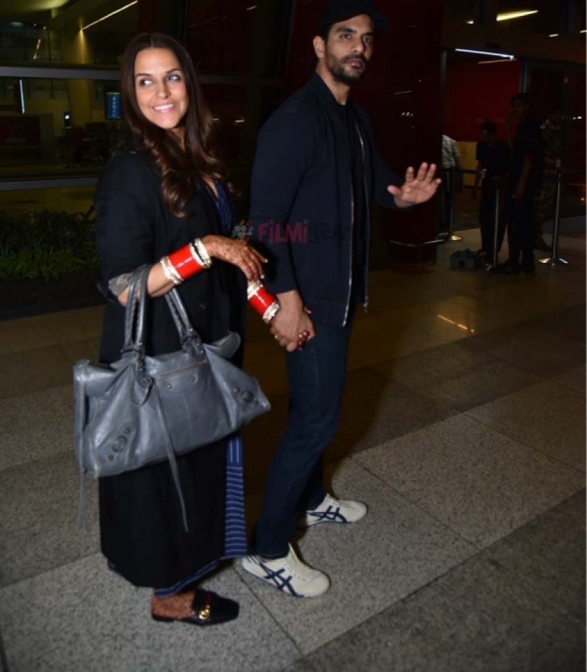 Newly Married Couple Neha Dhupia & Angad Bedi Spotted At Airport Photos