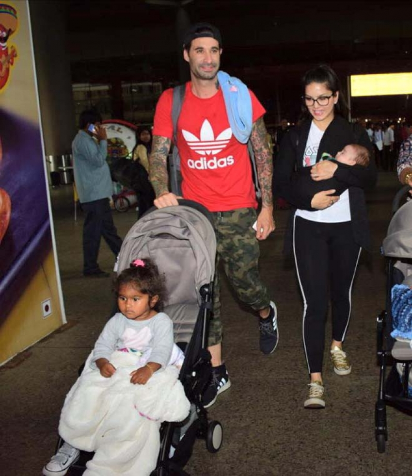 Sunny Leone Arrives Back In Mumbai With Her Kids Photos