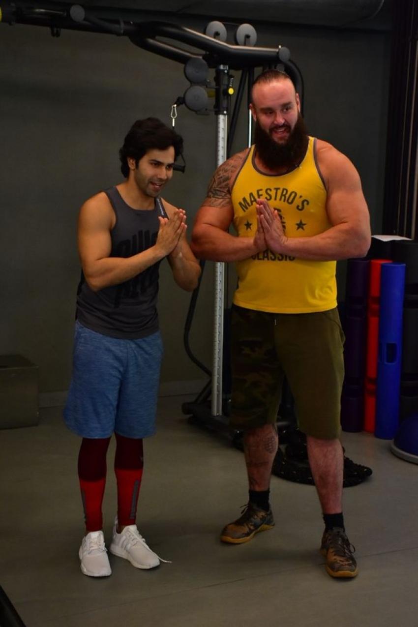 Varun Dhawan With  WWE Star In Mumbai Photos