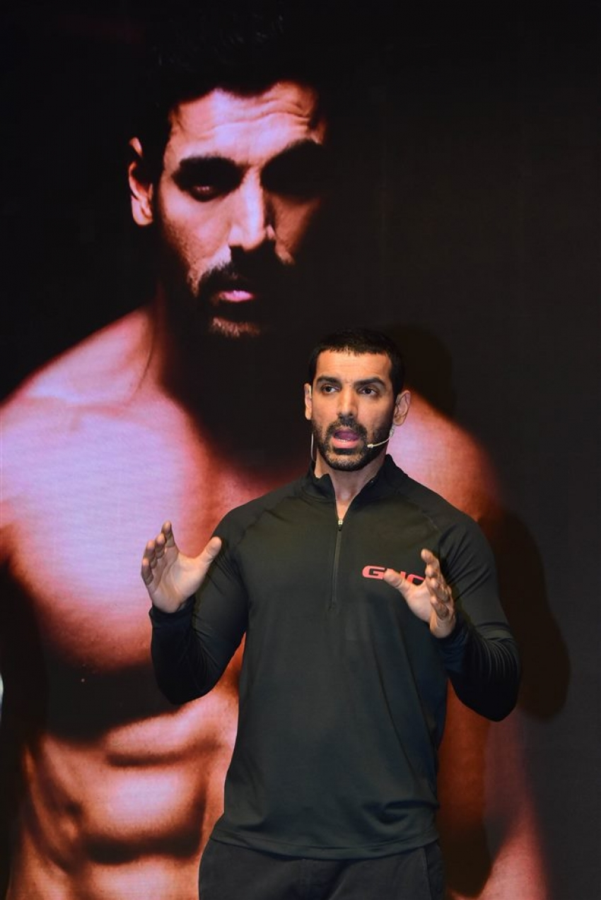 John Abraham Brand Ambassador For Wellness Brand GNC Photos