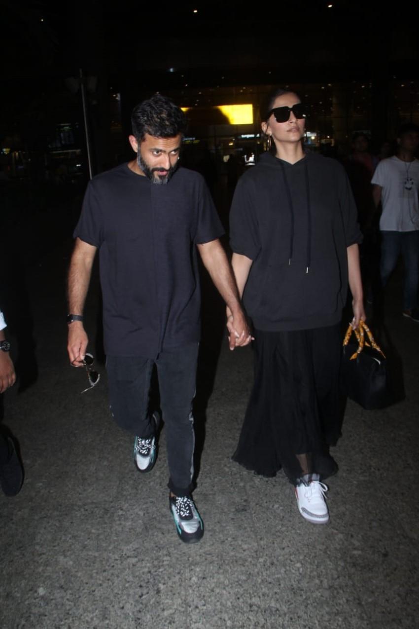 Sonam Kapoor & Anand Ahuja Snapped at Mumbai Airport Photos