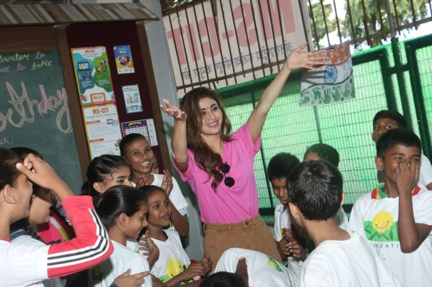 Mouni Roy snapped with the kids of Smile Foundation Photos