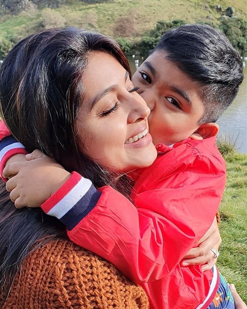 Actress Sneha with her family Photos